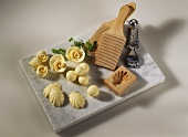 Variously-shaped butter pats, moulds, grooving tool