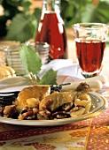 Coq au vin (chicken in wine sauce) with bacon, onions, garlic
