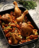Chicken in carrots & celery in a roasting dish