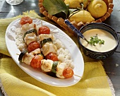 Fish & vegetable kebabs on rice & yellow pepper sauce