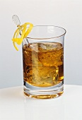 A glass of Rusty nail (whisky, Drambuie and ice cubes)