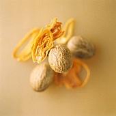 Three nutmegs and nutmeg flowers