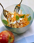 Raw carrots with grated apple, almonds, lemon balm