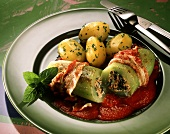 Cucumber stuffed with minced lamb & spinach, with bacon