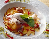 Nectarines & banana beignets, praline ice cream & fruit sauce