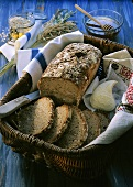 Finnenbrot (oat bread), piece cut, in basket & piece of butter