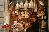 Italian grocer's shop with cheese, ham etc