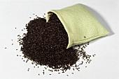 Flea seed (Plantago psyllium afra) falling out of linen sack
