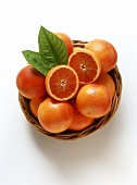 A Basket of Blood Oranges, One Cut in Half