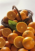 A Pile and a Basket of Oranges