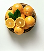 A Basket of Oranges with Leaves