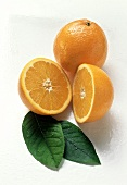 A Whole and Halved Orange with Leaves