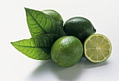 Three limes with leaves and half a lime