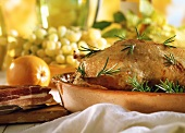 Roast duck with rosemary in the roasting dish