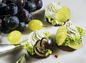 Pumpernickel canapes with gorgonzola & grapes