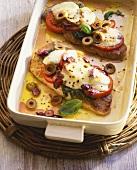 Pork escalope with tomatoes, pesto & toasted mozzarella