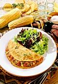 Corn pancake with lamb, bean & sweetcorn filling & salad
