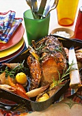 Pork chop with rosemary & vegetables in roasting dish