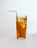 A glass of iced tea with ice cubes and straw
