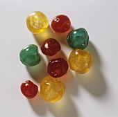 Red, yellow and green candied cherries