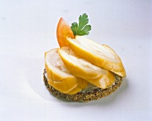 Cracker Topped with Salmon Pieces