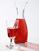 A Glass and Decanter of Red Wine