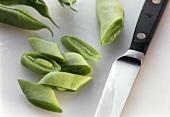 Flat green runner beans, shredded, with knife