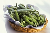 Various pea pods in a bast dish