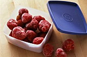 Frozen Strawberries in Plastic Container
