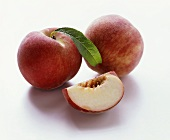 Two peaches and one peach quarter without stone
