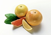 Whole pink & yellow grapefruits with grapefruit segments