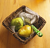 Blue cheese roll with pears and knife in basket