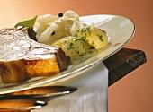 Smoked pork rib with parsley potatoes & sauerkraut on plate