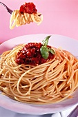 Spaghetti alla bolognese on plate and fork