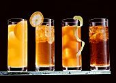 Four long drinks with rum