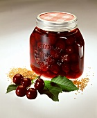 Mustard cherries in preserving jar (eaten with meat dishes)