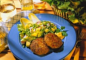 Frikadellas with mustard and salad on plate
