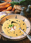 Cream of potato soup with pumpkin seeds in deep plate