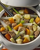 Beef and vegetable stew in a soup tureen