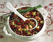 Red bean soup with chives in soup tureen