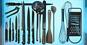 Various kitchen utensils (knife, mixing spoon, grater etc)
