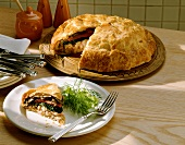 Vegetable and shrimp pie with mushrooms, a piece cut