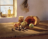 Still life with nuts, apples, lemons & pumpkin on table