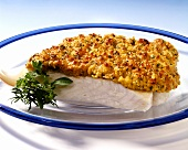 Baked cod fillet with breadcrumb and herb crust