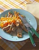 Turkey breast strips with carrots in mustard orange sauce