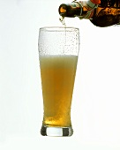 Pouring Weissbier from the bottle into a glass