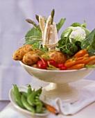 Vegetables in white bowl (potatoes, carrots, asparagus)