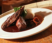 Kangaroo filet with bok choy & red wine sauce on plate