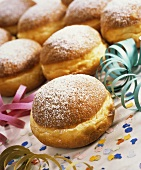 Fritters with icing sugar, with  confetti & paper streamers