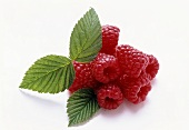 Raspberries with three leaves on white background